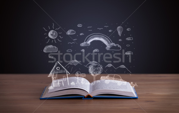 Stock photo: Open book with hand drawn landscape