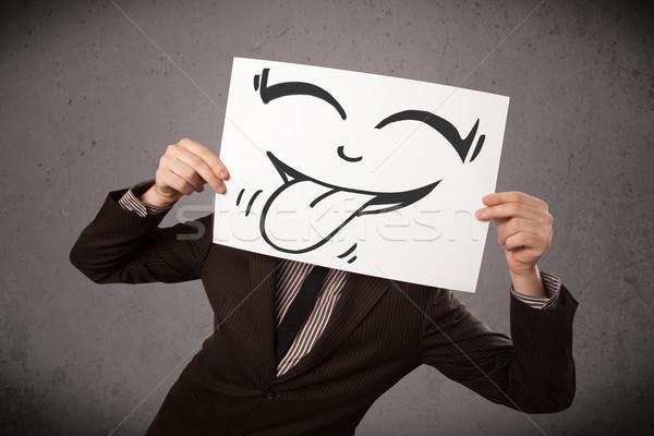 Empresário papel engraçado rosto sorridente jovem Foto stock © ra2studio