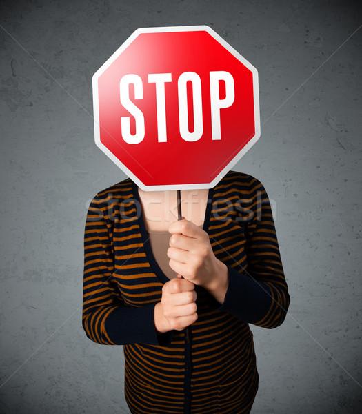 Genç kadın dur işareti genç bayan ayakta Stok fotoğraf © ra2studio