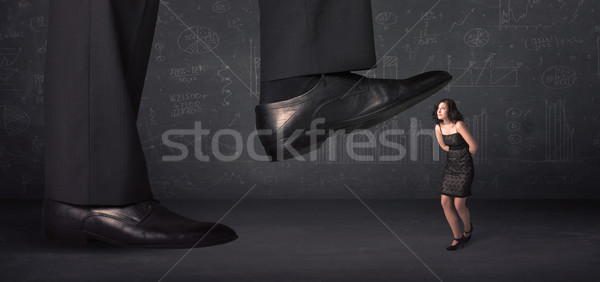 Huge leg stepping on a tiny businnesswoman concept Stock photo © ra2studio