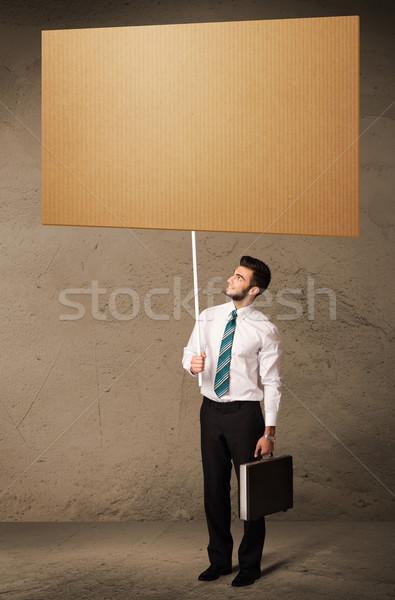 Stock photo: Businessman with blank cardboard