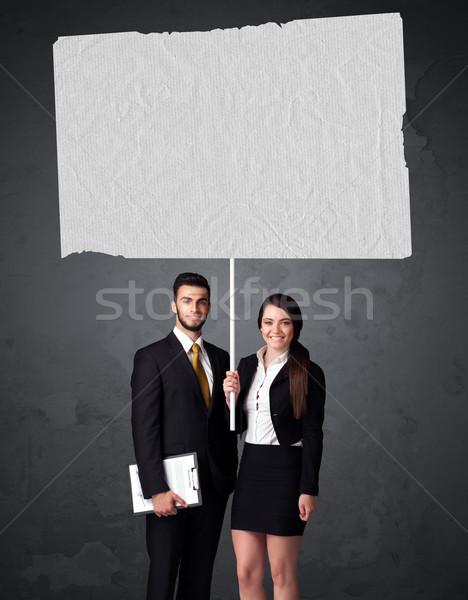 Affaires couple livret papier jeunes Photo stock © ra2studio