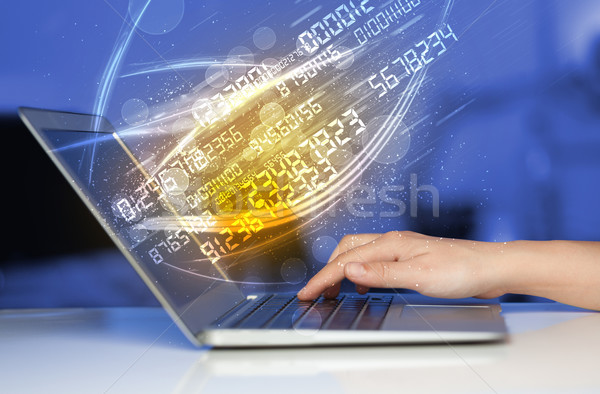 Stock photo: Man typing on modern notebook with number technology data coming