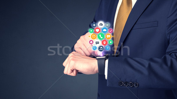 Businessman wearing smartwatch. Stock photo © ra2studio