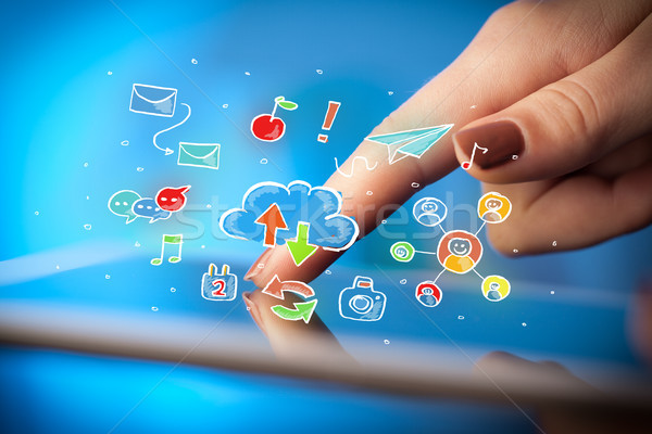 Fingers touching tablet with social icons Stock photo © ra2studio