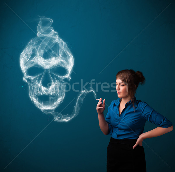 Młoda kobieta palenia niebezpieczny papierosów toksyczny czaszki Zdjęcia stock © ra2studio