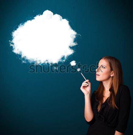 Młoda kobieta palenia niezdrowy papierosów gęsty dymu Zdjęcia stock © ra2studio
