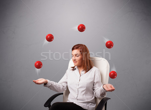 young girl sitting and juggling with red balls Stock photo © ra2studio