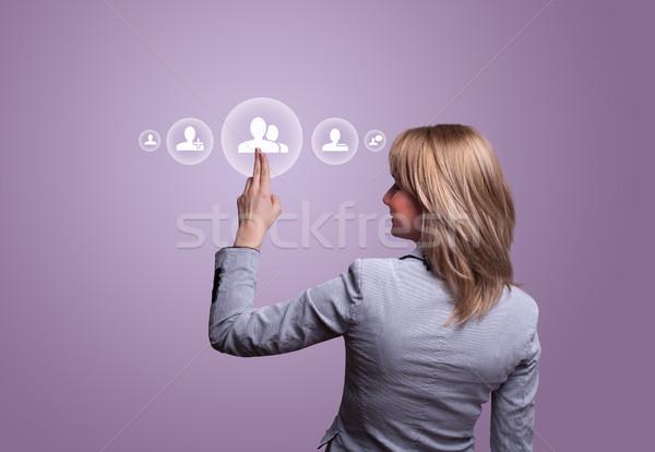 hand pressing social network icon Stock photo © ra2studio