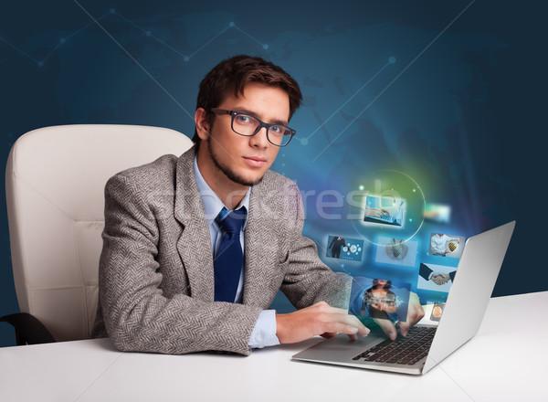 çekici genç oturma büro izlerken fotoğraf Stok fotoğraf © ra2studio