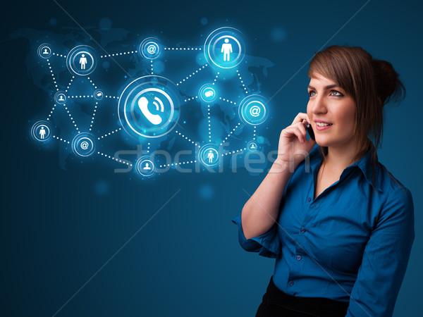 Csinos lány készít telefonbeszélgetés közösségi háló ikonok Stock fotó © ra2studio