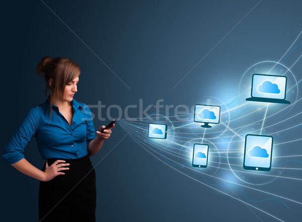 Pretty lady typing on smartphone with cloud computing Stock photo © ra2studio