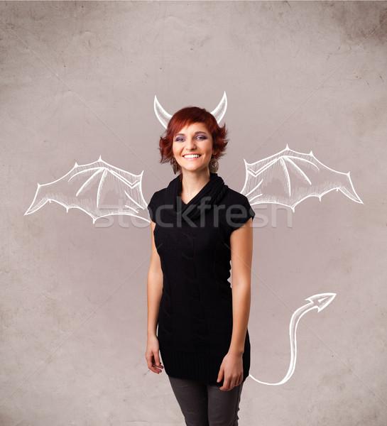 Fiatal lány ördög agancs szárnyak rajz fiatal Stock fotó © ra2studio