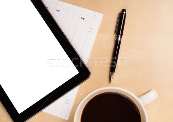 Tablet pc with empty space and a cup of coffee on a desk Stock photo © ra2studio