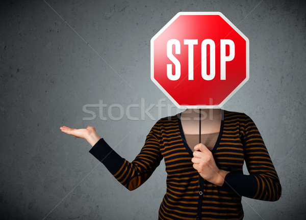Jonge vrouw stopteken jonge dame permanente Stockfoto © ra2studio