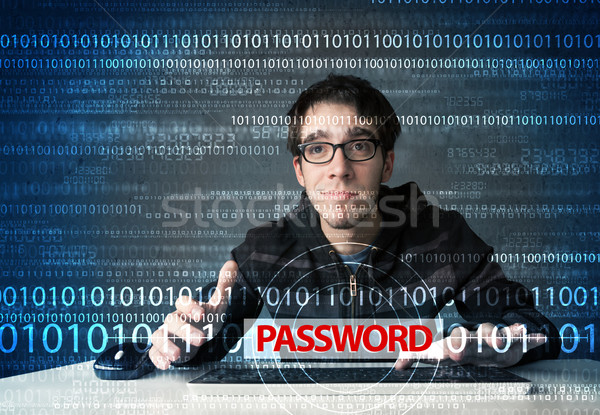 Young geek hacker stealing password  Stock photo © ra2studio