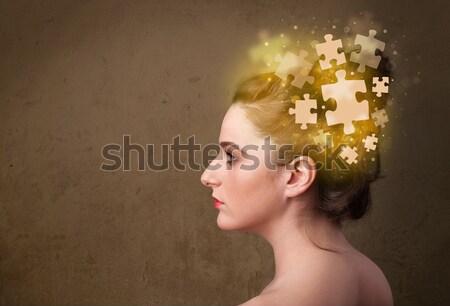 Fiatal személy gondolkodik izzó puzzle elme Stock fotó © ra2studio