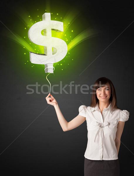 Zakenvrouw dollarteken ballon groene Stockfoto © ra2studio