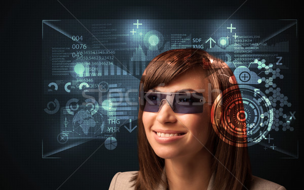 Young woman looking with futuristic smart high tech glasses  Stock photo © ra2studio