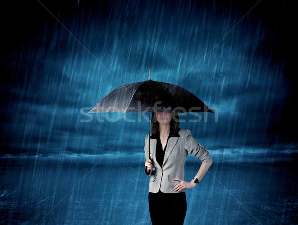 деловой женщины Постоянный дождь зонтик бизнеса моде Сток-фото © ra2studio