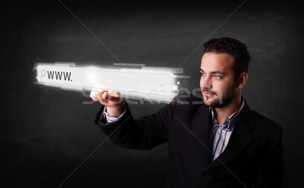 молодые бизнесмен прикасаться веб браузер адрес Сток-фото © ra2studio