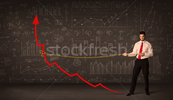 Businessman pulling a red arrow upright with a rope  Stock photo © ra2studio