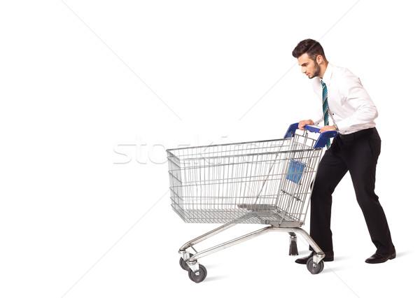 Biznesmen koszyk popychanie odizolowany człowiek zakupy Zdjęcia stock © ra2studio