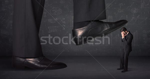 Enorme gamba minuscolo uomo sfondo suit Foto d'archivio © ra2studio
