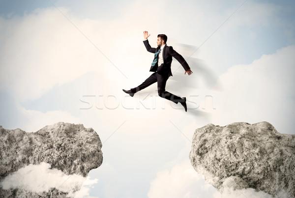 Gelukkig zakenman springen klif business man Stockfoto © ra2studio