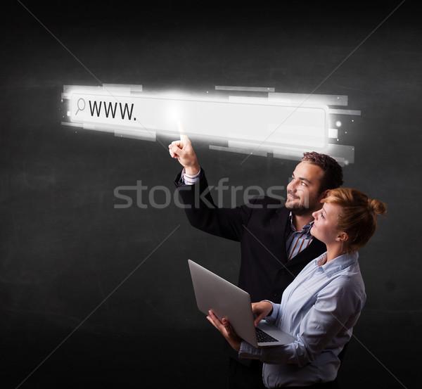 Jovem negócio casal tocante teia navegador Foto stock © ra2studio