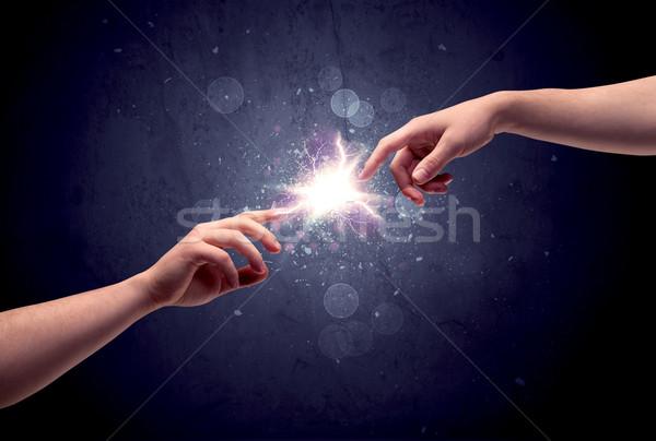 Mains lumière susciter deux Homme autre Photo stock © ra2studio