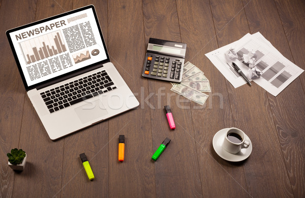 Business laptop with stock market report on wooden desk Stock photo © ra2studio