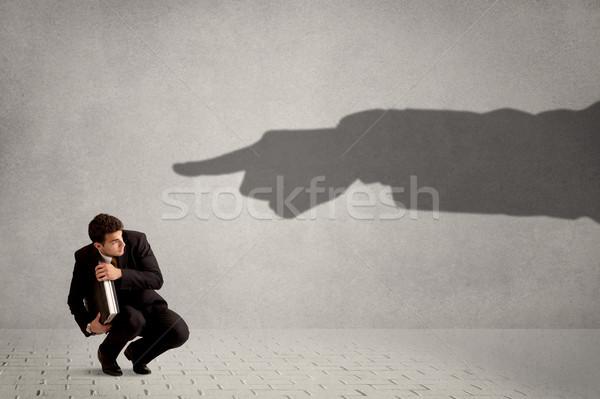 Mirando enorme sombra mano senalando Foto stock © ra2studio