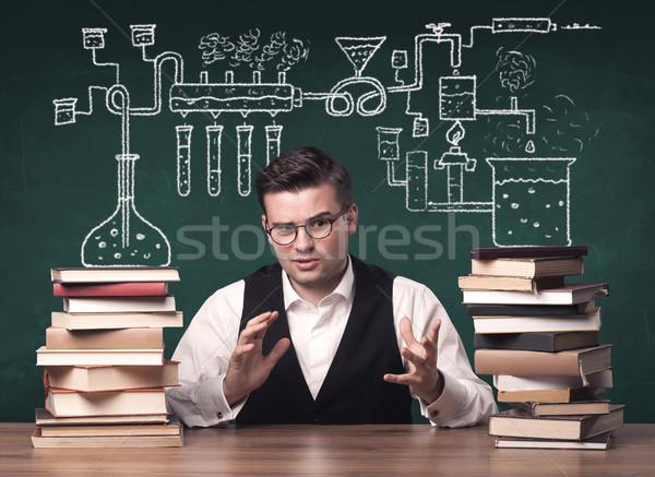 Teacher at chemistry class Stock photo © ra2studio