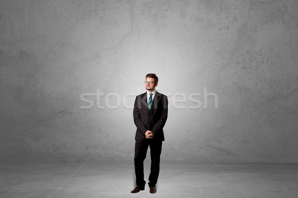 Alone businessman standing in a dark room Stock photo © ra2studio