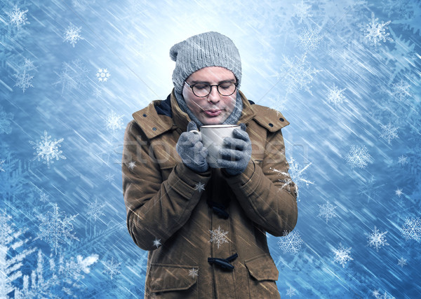 Boy freezing in warm clothing and snowing concept Stock photo © ra2studio