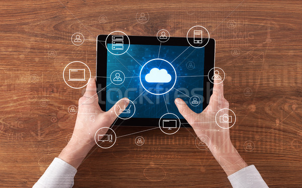 Hand using tablet with centralized cloud computing system concept Stock photo © ra2studio