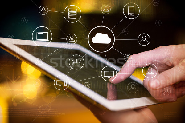 Hand working in tablet graphs and charts and reports concept around Stock photo © ra2studio
