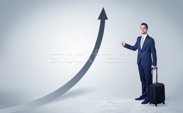 Businessman hitchhiking with progressive arrow Stock photo © ra2studio