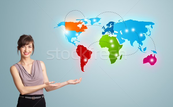Young woman presenting colorful world map Stock photo © ra2studio