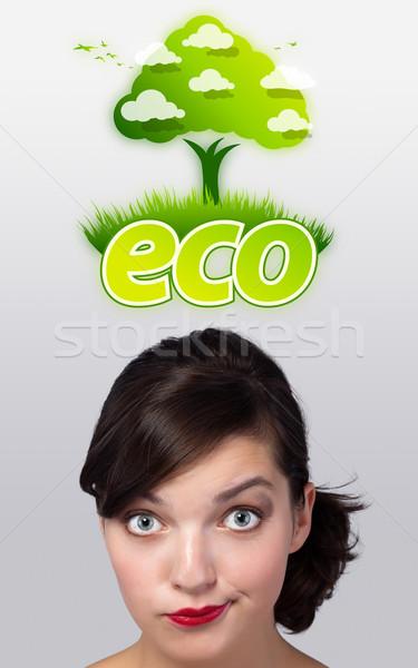 Young girl looking at green eco sign Stock photo © ra2studio