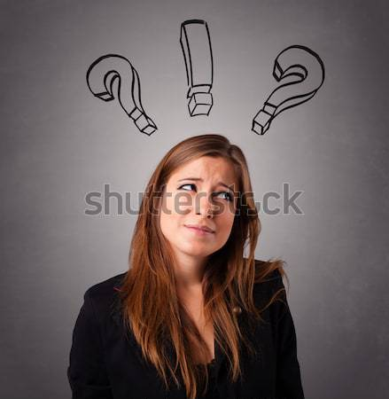 Young lady thinking with question marks overhead Stock photo © ra2studio