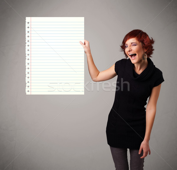 Young woman holding white paper copy space with diagonal lines Stock photo © ra2studio
