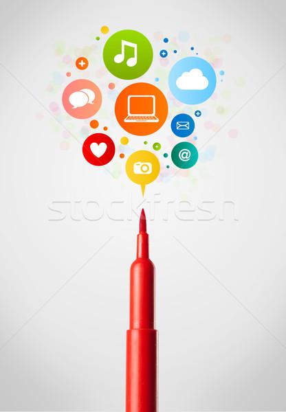 Felt pen close-up with social network icons Stock photo © ra2studio