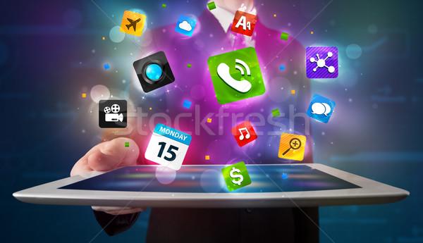 Stock fotó: Fiatal · üzletember · tart · tabletta · modern · színes