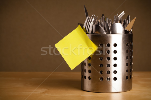 Empty post-it note sticked on cutlery case Stock photo © ra2studio