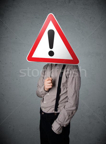 üzletember tart jelzőtábla piros forgalom háromszög Stock fotó © ra2studio