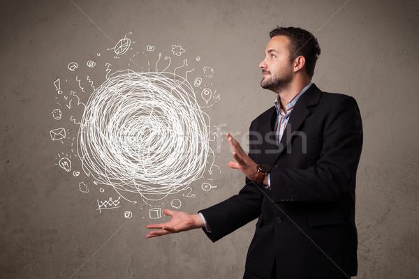 Káosz kéz üzletember fiatal tart férfi Stock fotó © ra2studio