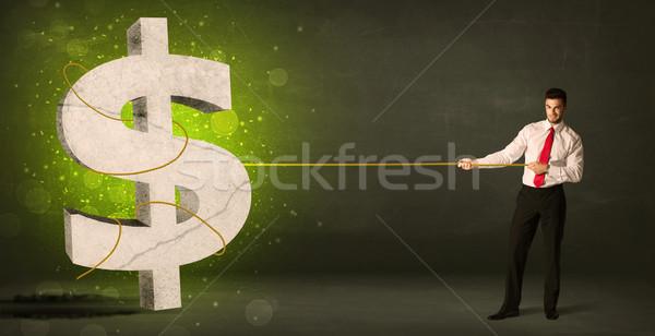 Homme d'affaires grand vert signe du dollar argent Photo stock © ra2studio