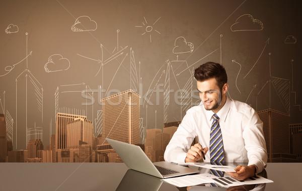 üzletember épületek ül fekete asztal papír Stock fotó © ra2studio